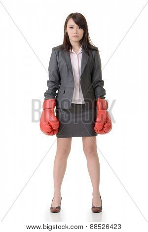 Fighting businesswoman with glove, full length portrait on white background.