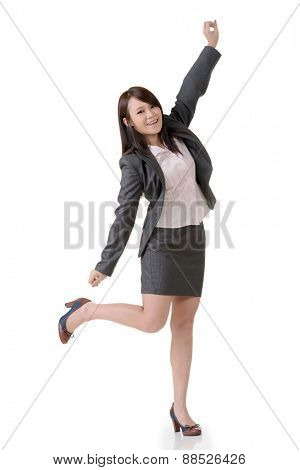 Cheerful business woman with exciting expression, full length portrait on white background.