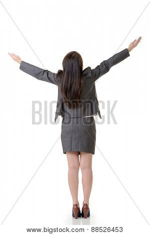 Rear view of business woman open arms and feel free, full length portrait on white background.