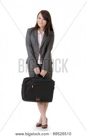 Friendly business woman holding briefcase, full length portrait on white background.