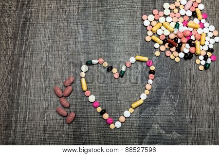 Colorful Pills In The Shape Of The Heart
