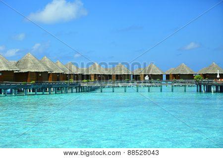 Water villas over blue ocean in baros Maldives