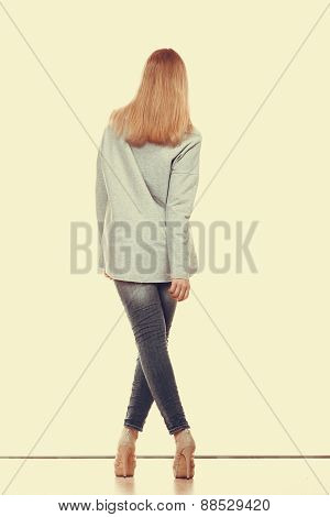 Woman In Denim Pants High Gray Shirt Back View