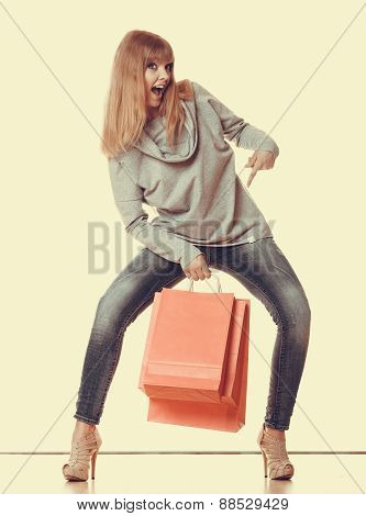 Girl In Full Length With Red Shopping Bags