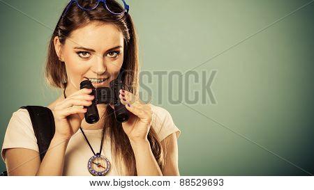 Tourist Woman Looking Through Binoculars