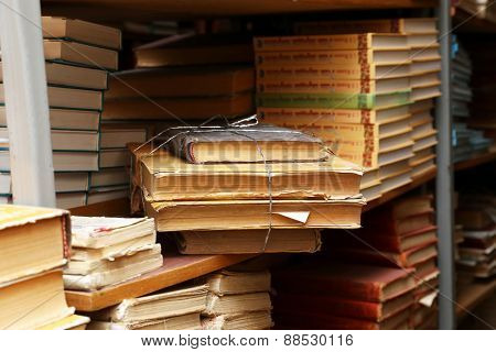 Many books on bookshelf in library