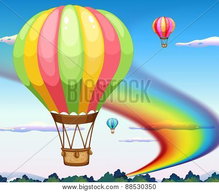 Balloons flying in the sky with rainbow background