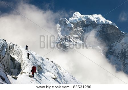 Group Of Climbers On Mountains