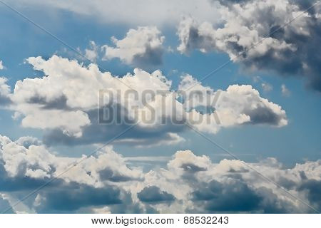 Picturesque Gray Cumulus Clouds In The Blue Sky