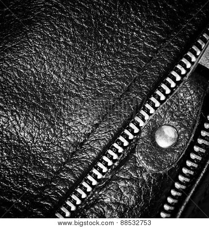 Black Leather Clothing With A Zipper. Macro Photo