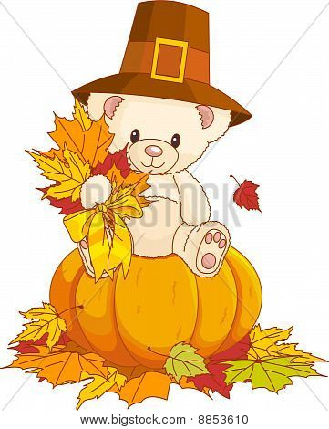 Teddy Bear With Pilgrim Hat Sitting On Pumpkin