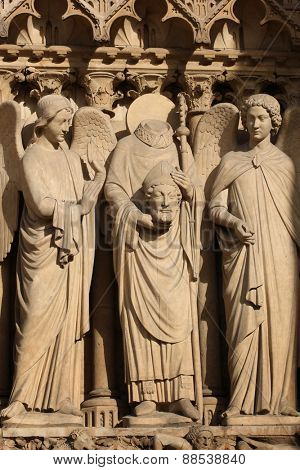 Details of three statues on a the front of the Cathedral Notre Dame de Paris, in France