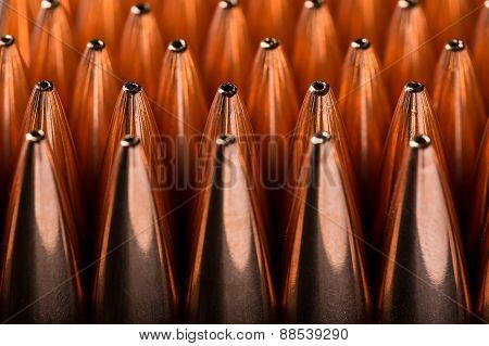 Macro shot of copper bullets that are in many rows