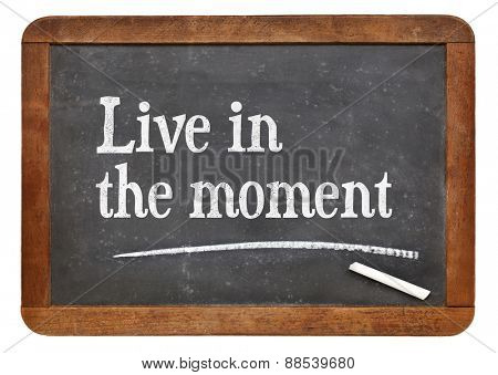 Live in the moment i- inspirational advice on a vintage slate blackboard