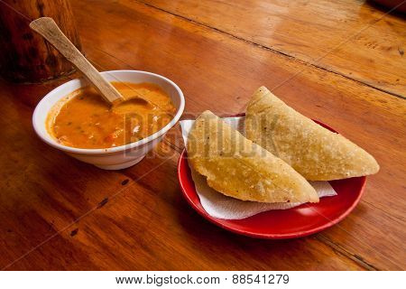 Morocho empanadas served with chilli sauce