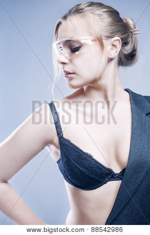 Fashion And Beauty Concept: Proudly Looking Caucasian Female In Gray Suite Demonstrating Lingerie An