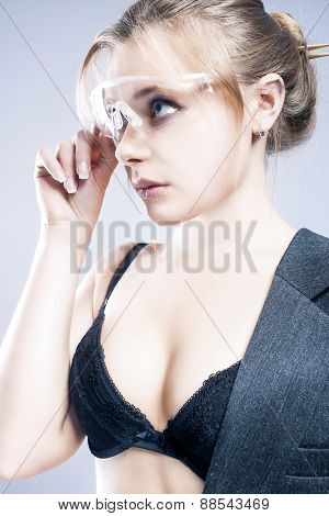 Portrait Of Young Caucasian Blond Female In Black Lingerie Touching Transparent Glasses. Posing Agai