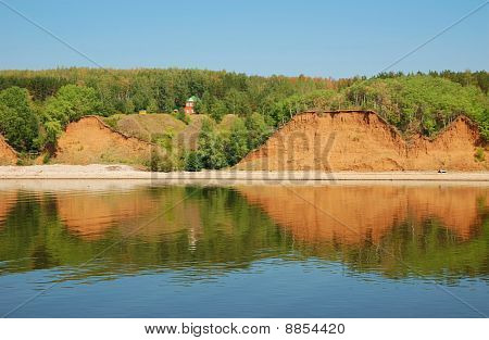 Hills On A River Bank