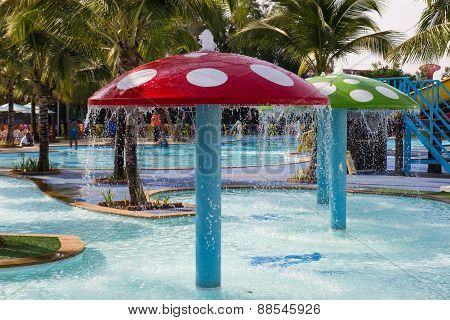 Red Mushroom Shape Fountain Decorating In The Pool