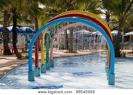 Colorful Arch Fountain Decorating In The Pool