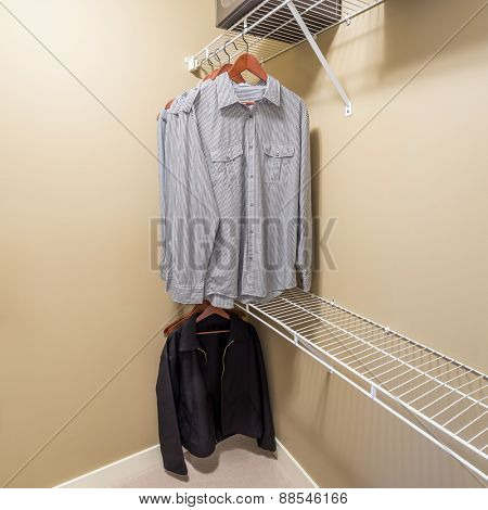 A clothing closet, working closet, cupboard in bedroom.