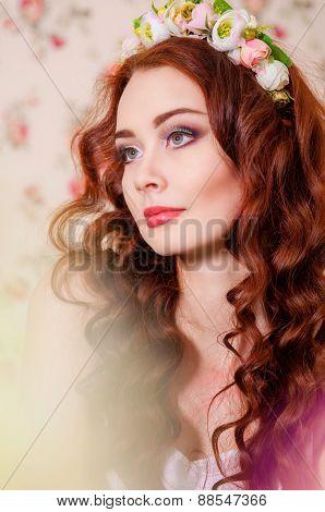 Girl with long fair hair in a  wreath
