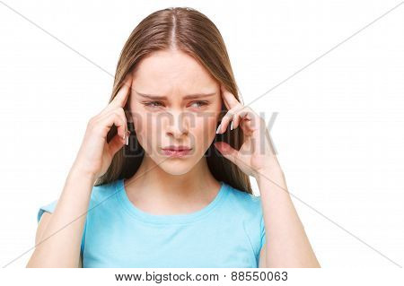 Young Beautiful Woman With Headache Isolated On White.