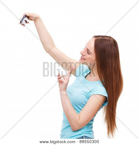 Beautiful Young Woman Taking A Picture Of Herself With Her Camera Phone - Isolated On White.