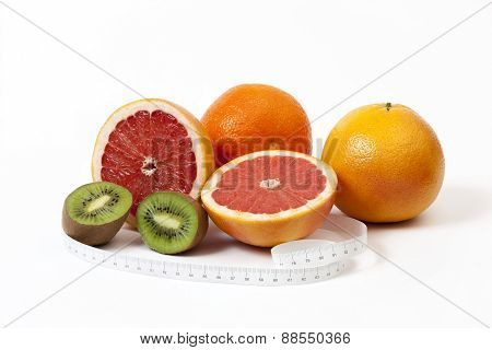 Group Of Tropical Fruits And Tape Measure In Centimeters