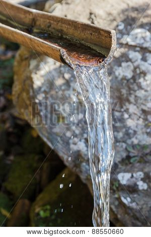 Water Flowing Through Bamboo