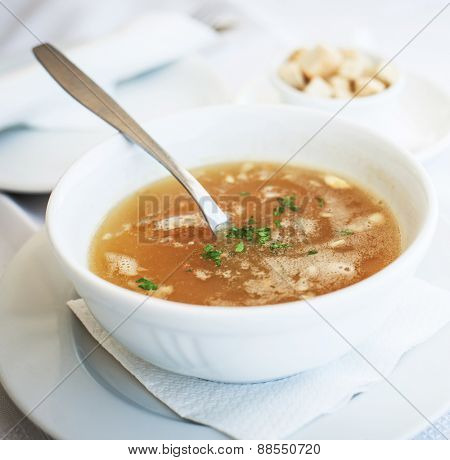 traditional chicken soup served in a bowl over  white background