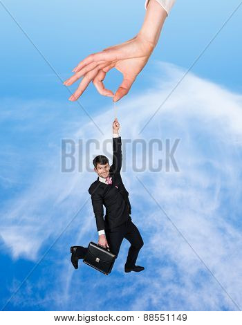 Businessman hanging