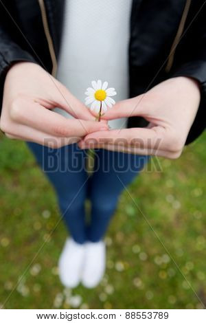 Woman with a flower in her hand. Spring came