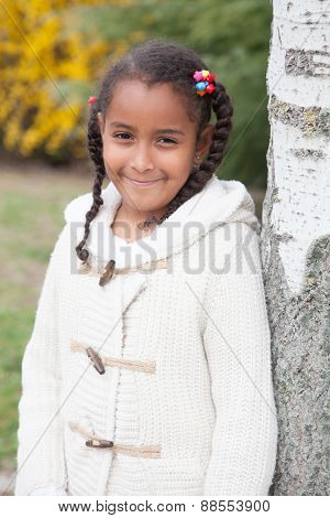 Pretty african girl with winter clothes in the park