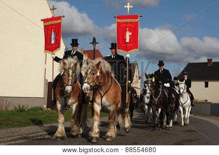 RALBITZ, GERMANY - APRIL 8, 2012: Easter Riders attend the Easter ceremonial equestrian procession in the Lusatian village of Ralbitz near Bautzen, Upper Lusatia, Saxony, Germany.