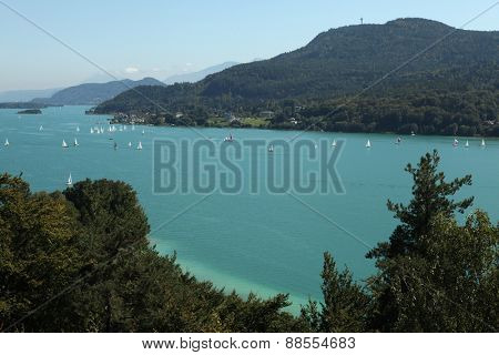 WORTHERSEE, AUSTRIA - SEPTEMBER 3, 2011: Sailing ships on Worthersee Lake (Lake Worth) in Carinthia, Austria.