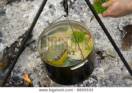 Cooking Fish Soup On The Fire