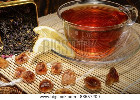 tea composition with lemon on a wooden background