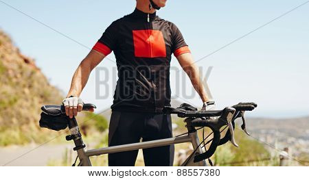 Cyclist Standing With His Bike - Outdoors