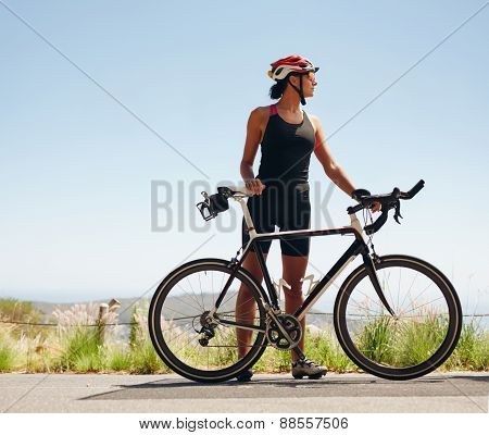 Young Female Cyclist Looking Away