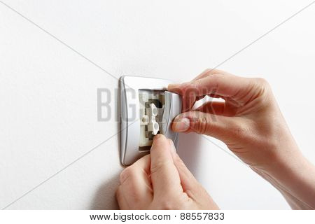 Electrician Installing A Light Switch Cover