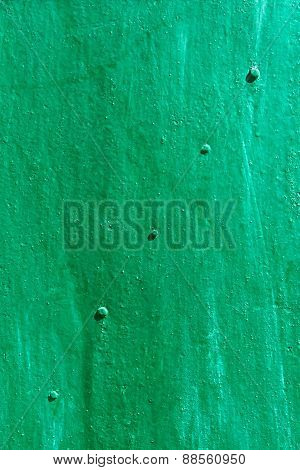 Green Painted Metal Sheet With Rivets Diagonally