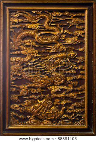 Dragon sculpture on temple door- Vietnam 2015