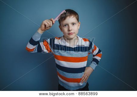 teenager boy of about ten European appearance brown hair combs h