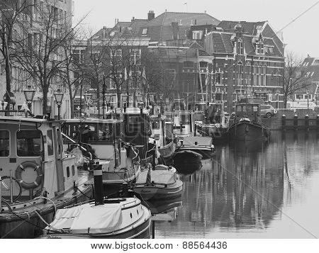 Canal and boats at the harbor of Leiden