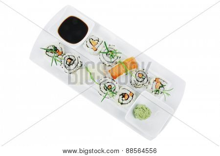 Roll with Cucumber , Cream Cheese with raw Tuna and Salmon inside. on long white plate . Isolated over white background . Japanese traditional Cuisine