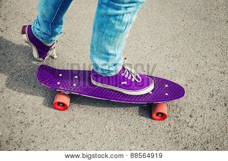 Skateboarder In Jeans, Feet Fragment With Skate