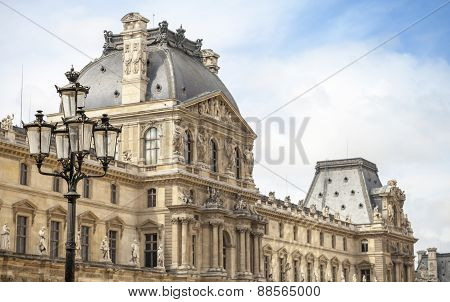 Black Street Lamp And Facade Of The Louvre Museum