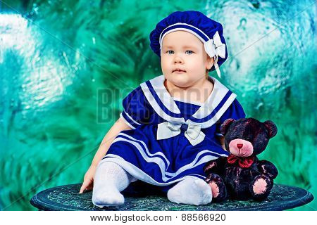 Cute baby girl in beautiful dress. Newborn. Happy childhood.