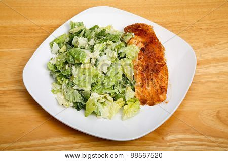 Baked Salmon With Ceasar Salad On Square Plate